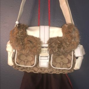Fur-trimmed Coach bag